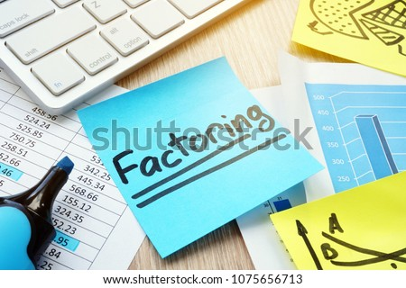 Stick with word factoring on a desk. Factor concept. Foto stock ©
