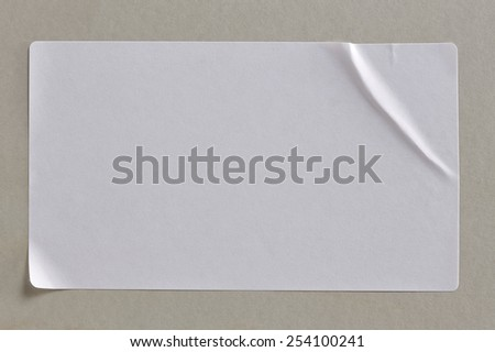 Stickers Label Close Up on Cardboard Background with Real Shadow. Top View of Adhesive Paper Tag. Copy Space for Text or Image #254100241
