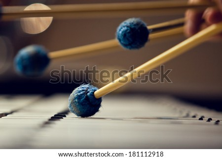 Sticks hitting a xylophone closeup #181112918