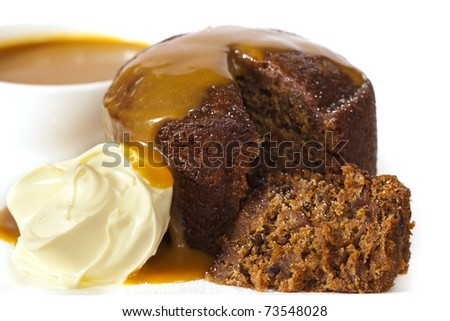 Sticky date pudding topped with caramel sauce and fresh cream.  Delicious!