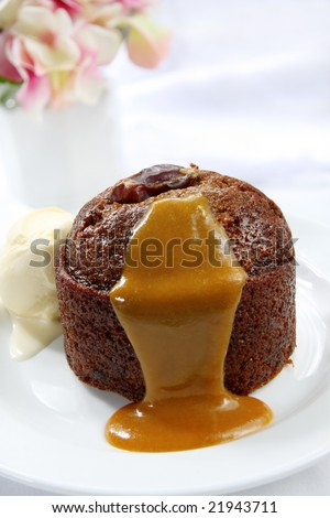 Sticky date pudding with caramel sauce and vanilla ice cream.  A rich, indulgent dessert.