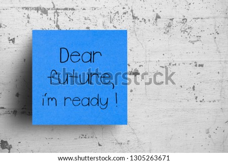 Sticky note on concrete wall, Dear future #1305263671