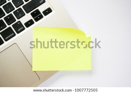 Sticky note on laptop with copy space. For all concept #1007772505