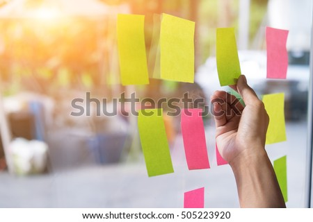 Sticky note paper reminder schedule board. Business people meeting and use post it notes to share idea on sticky note. Discussing - business, teamwork, brainstorming concept vintage tone. #505223920
