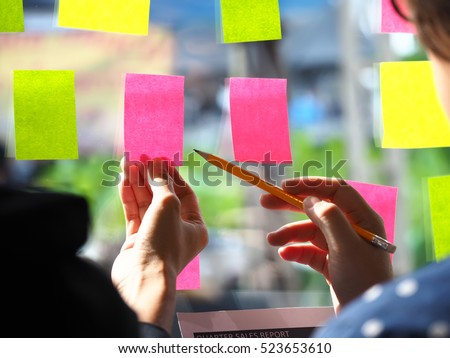 Sticky note paper reminder schedule board. Business people meeting and use post it notes to share idea on sticky note. Discussing - business, teamwork, brainstorming concept vintage tone