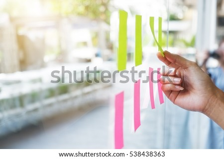 Sticky note paper reminder schedule board. Business people meeting and use post it notes to share idea on sticky note. Discussing - business, teamwork, brainstorming concept vintage tone.
