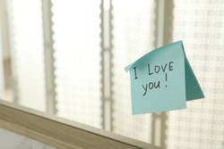 Sticky note with phrase I love you! on mirror, space for text