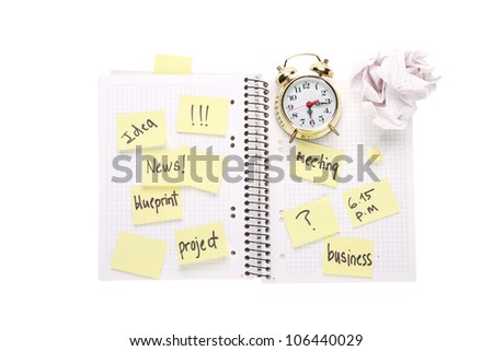 sticky notes and clock in exercise book