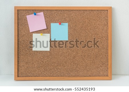 sticky notes on cork bulletin board