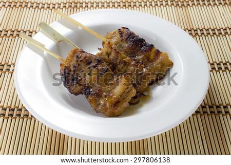 Sticky Pork bbq traditional thai food on white dish