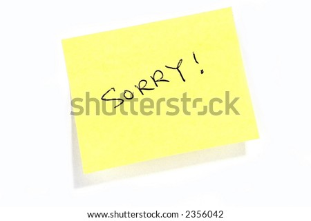 "Sticky post it note with ""Sorry"" wording."