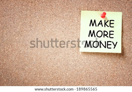 sticky with the phrase make more money written on it. room for text.