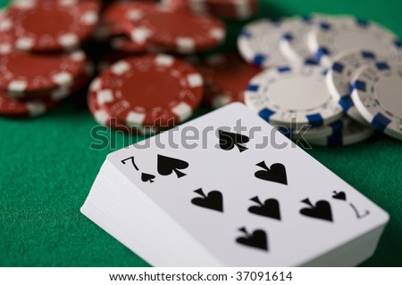 STILL IMAGE-cards and tips on the casino table