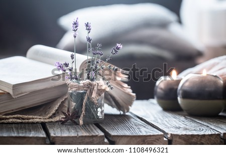 still life a book and a candle on a wooden table, the concept of coziness and reading Stockfoto ©