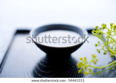 STILL LIFE-a cup of sake on a tray