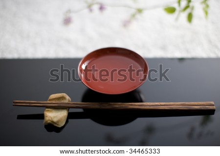 STILL LIFE-a pair of chopsticks and a cup of sake on a table tray