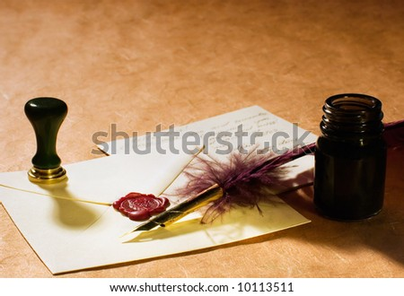 Still-life about a love letters with a quill, an inkwell & a stamp on a rustic paper.