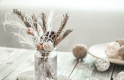 Still life beautiful vase with dried flowers . The concept of comfort and home decor. Close up. Modern style in the interior .