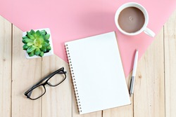 Still life, business, office supplies, planning or education concept : Top view or flat lay of open notebook with blank pages and coffee cup on office table with copy space ready for adding or mock up