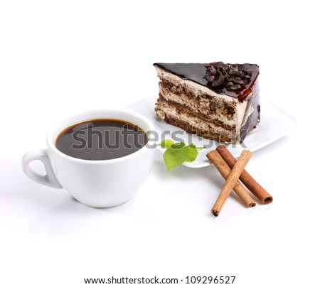 still-life composed of chocolate cake, coffee and delicate green on white background