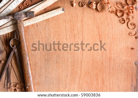 still-life composition of grungy old hand tools on wood texture, empty space for text