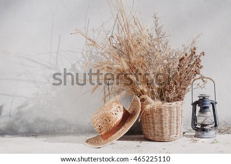 still life country with lantern and wicker basket. boho chic style decorations #465225110