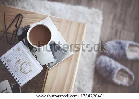 Still life details cup of coffee and retro vintage black-and-white photos top view point