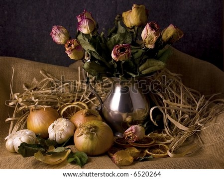 Still-life - Dried roses, onions and garlic on dark background - Dutch old masters style