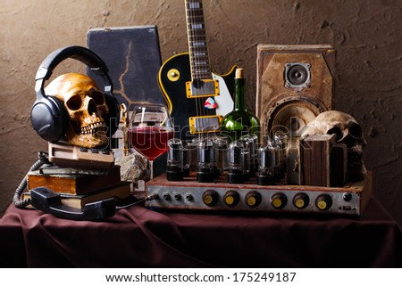 Still life fine art photography on high fidelity concept with vintage tube valve amplifier wine electric guitar and speaker  #175249187
