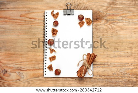Free photos wooden spoon notebook recipe book spices on a wooden still life food and drink concept notepad for recipes and assortment of nuts and forumfinder Image collections
