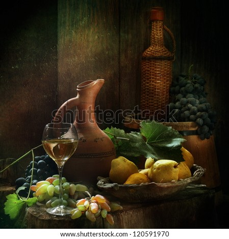 Still-life, glass of fragrant white wine and juicy fresh appetizing fruit fruit - stock photo