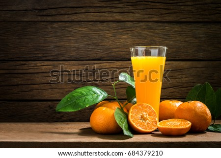 Still Life Glass of Fresh Orange Juice on Vintage Wood Table with Copy Space Background #684379210