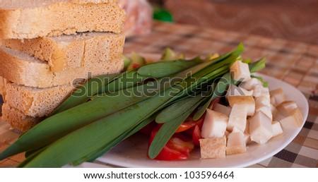 still-life, green onions, bread, bacon - stock photo