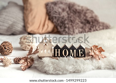Still life home decor in a cozy house with wooden letters with the inscription home. The concept of decor and comfort . #1499299223