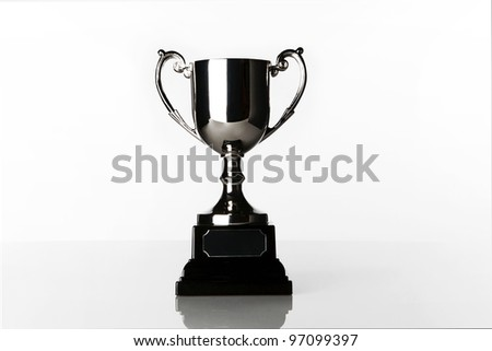 still life image of a single trophy standing in a white background