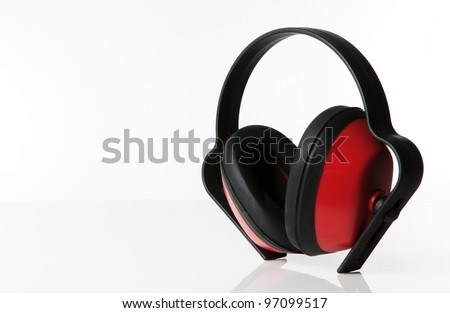 still life image of ear defenders standing on a white background