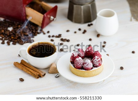 still life in rustic style, fresh tartlet with raspberries and hot espresso #558211330