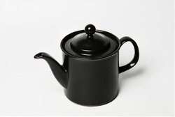 still life of a beautiful black coffee pot on white background