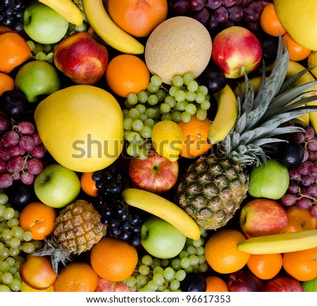still life of big  heap multi-coloured fruits, square background - stock photo