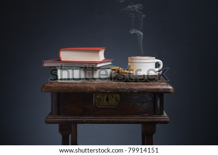 Still life of books and a cup of coffee.