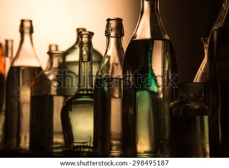 Still Life of Bottles in the homemade distillery cellar. #298495187