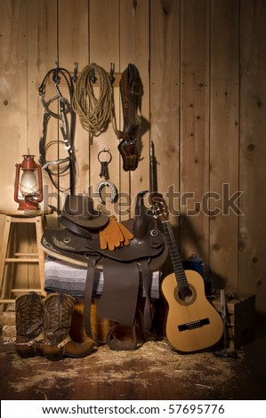 Still life of cowboy paraphernalia in the tack room of a barn