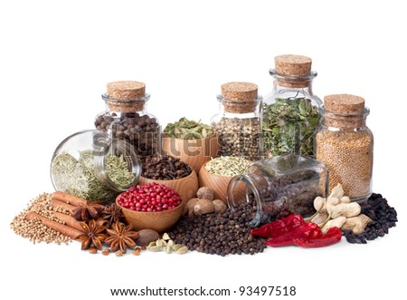 still life of different spices and herbs isolated on white background