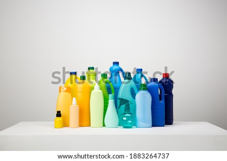 Still life of different types of plastic packaging on white and grey set arranged by colours Foto stock ©