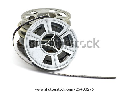 still life of dirty, old 8mm cine film and reels; isolated on white ground
