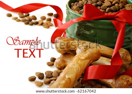 Still life of dog food and healthy treats with red ribbon on white background with copy space.  Macro with shallow dof.