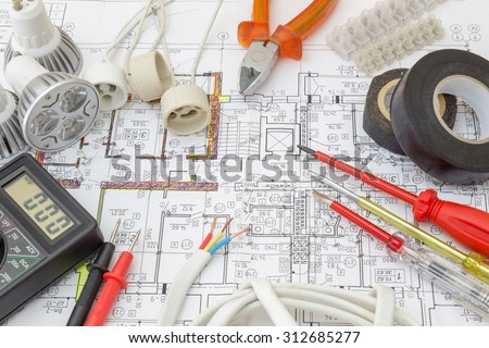 Still Life Of Electrical Components Arranged On Plans #312685277