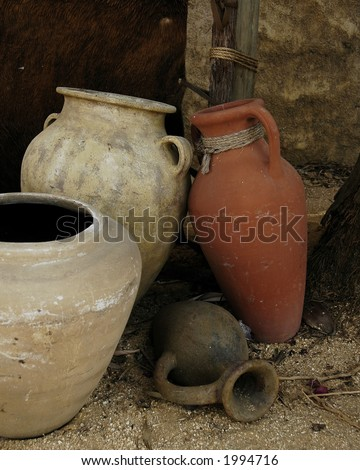 Still  life of four clay pots representing those of ancient days.  (Replicas)