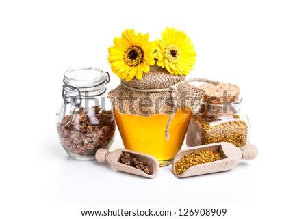Still life of fresh honey on white background