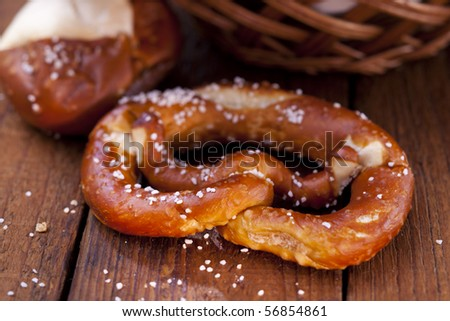 Still life of fresh pretzel with salt